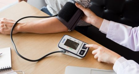 doctor-and-patient-measuring-blood-pressure_1423-2407